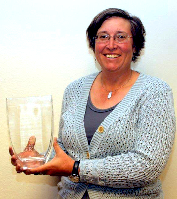 Bonnie Warnock with Eco Restoration award